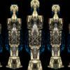 Penta gold pillars metamorphosing shape on black background Wallpaper