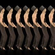Beauty-Blonde-Girl-Team-in-Covid-19-black-mask-dancing-on-black-background-4K-Video-VJ-Footage-1920_004 VJ Loops Farm