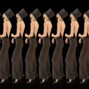 Beauty-Blonde-Girl-Team-in-Covid-19-black-mask-dancing-on-black-background-4K-Video-VJ-Footage-1920_008 VJ Loops Farm